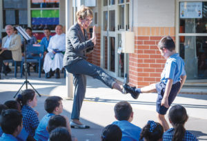 Governor of NSW Margaret Beazley and Holy Spirit Carness Hill student Nicholas doing karate moves